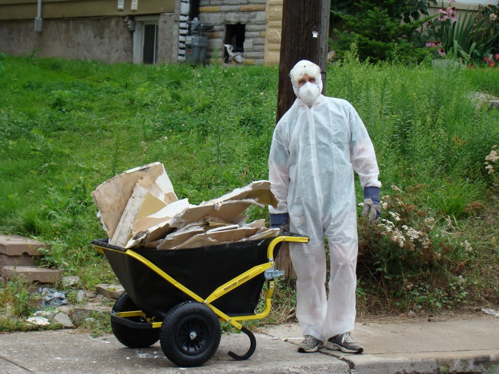 asbestos removal technician during work